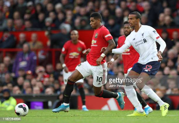 Marcus Rashford of Manchester United in action with Joel Matip of Liverpool during the Premier League match between Manchester United and Liverpool...