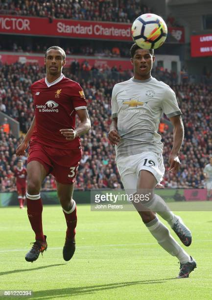 Marcus Rashford of Manchester United in action with Joel Matip of Liverpool during the Premier League match between Liverpool and Manchester United...
