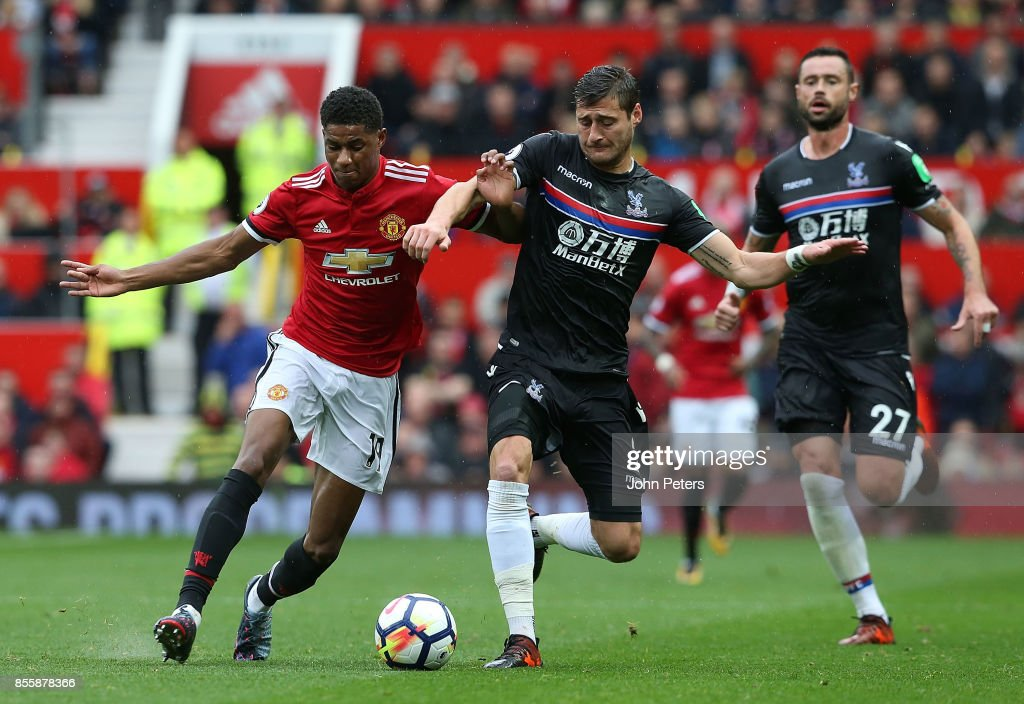 Marcus Rashford of Manchester United in action with Joel Ward of Crystal Palace during the Premier League match between Manchester United and Crystal Palace at Old Trafford on September 30, 2017 in Manchester, England.