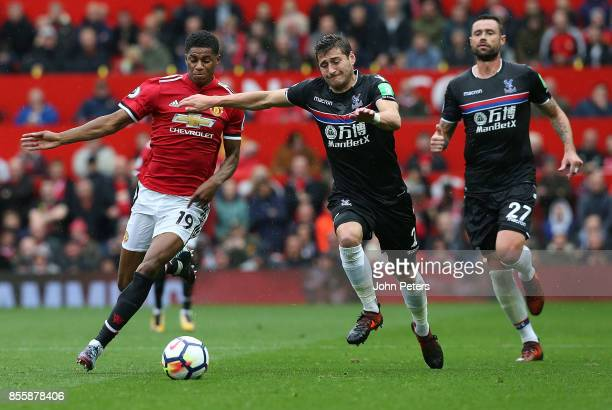 Marcus Rashford of Manchester United in action with Joel Ward of Crystal Palace during the Premier League match between Manchester United and Crystal...