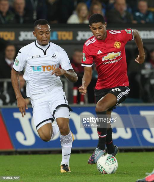 Marcus Rashford of Manchester United in action with Jordan Ayew of Swansea City during the Carabao Cup Fourth Round match between Swansea City and...
