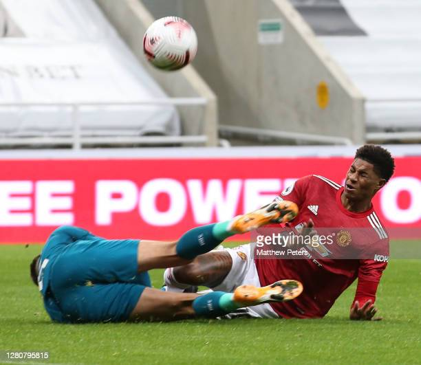 Marcus Rashford of Manchester United in action with Karl Darlow of Newcastle United during the Premier League match between Newcastle United and...