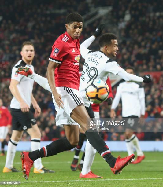 Marcus Rashford of Manchester United in action with Marcus Olsson of Derby County during the Emirates FA Cup Third Round match between Manchester...