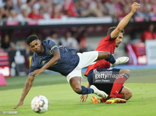 Marcus Rashford of Manchester United in action with Mats Hummels of Bayern Munich during the preseason friendly match between Bayern Munich and...