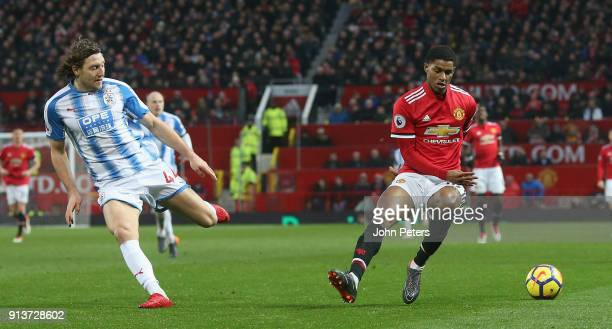 Marcus Rashford of Manchester United in action with Michael Hefele of Huddersfield Town during the Premier League match between Manchester United and...
