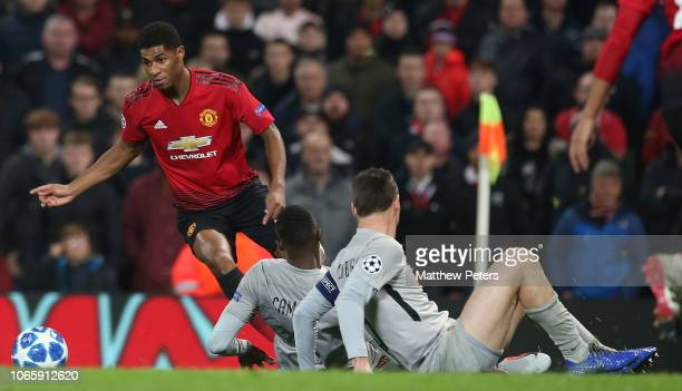 Marcus Rashford of Manchester United in action with Mohamed Ali Camara and Steve von Bergen of BSC Young Boys during the Group H match of the UEFA...