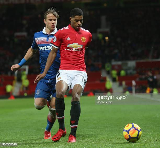 Marcus Rashford of Manchester United in action with Moritz Bauer of Stoke City during the Premier League match between Manchester United and Stoke...