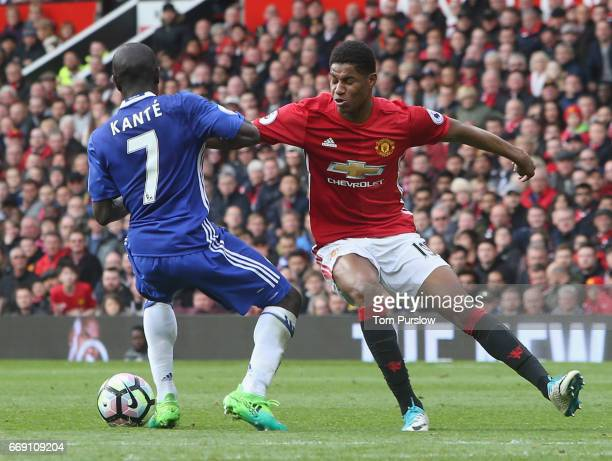 Marcus Rashford of Manchester United in action with Ngolo Kante of Chelsea during the Premier League match between Manchester United and Chelsea at...