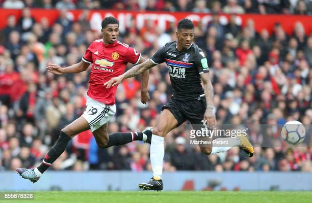 Marcus Rashford of Manchester United in action with Patrick van Aanholt of Crystal Palace during the Premier League match between Manchester United...