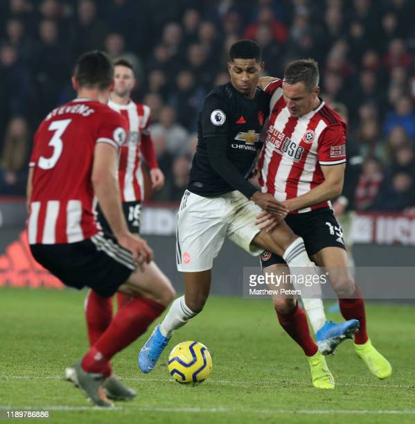 Marcus Rashford of Manchester United in action with Phil Jagielka of Sheffield United during the Premier League match between Sheffield United and...