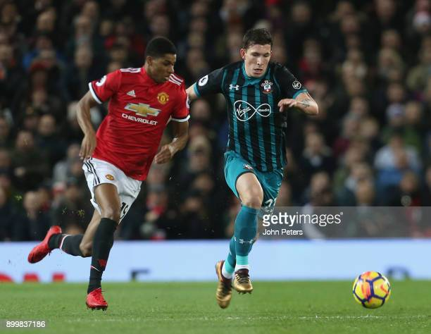 Marcus Rashford of Manchester United in action with PierreEmile Hojbjerg of Southampton during the Premier League match between Manchester United and...