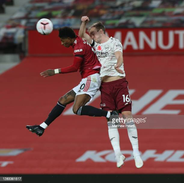Marcus Rashford of Manchester United in action with Rob Holding of Arsenal during the Premier League match between Manchester United and Arsenal at...
