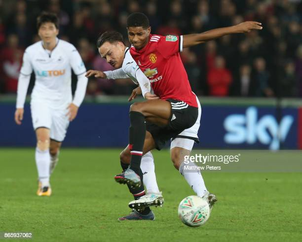 Marcus Rashford of Manchester United in action with Roque Mesa of Swansea City during the Carabao Cup Fourth Round match between Swansea City and...