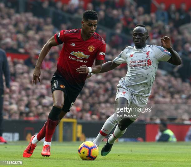 Marcus Rashford of Manchester United in action with Sadio Mane of Liverpool during the Premier League match between Manchester United and Liverpool...