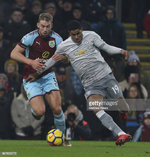 Marcus Rashford of Manchester United in action with Scott Arfield of Burnley during the Premier League match between Burnley and Manchester United at...