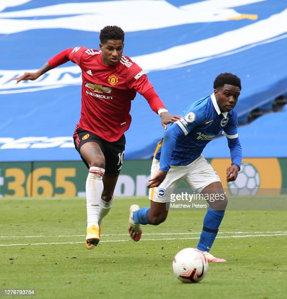Marcus Rashford of Manchester United in action with Tariq Lamptey of Brighton and Hove Albion during the Premier League match between Brighton & Hove...