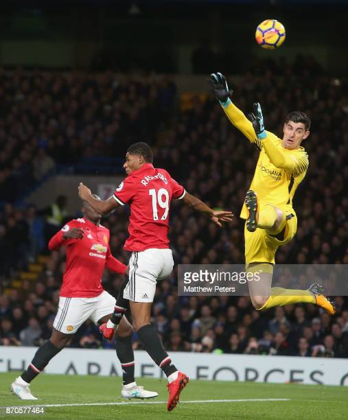 Marcus Rashford of Manchester United in action with Thibaut Courtois of Chelsea during the Premier League match between Chelsea and Manchester United...