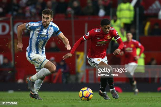 Marcus Rashford of Manchester United in action with Tommy Smith of Huddersfield Town during the Premier League match between Manchester United and...