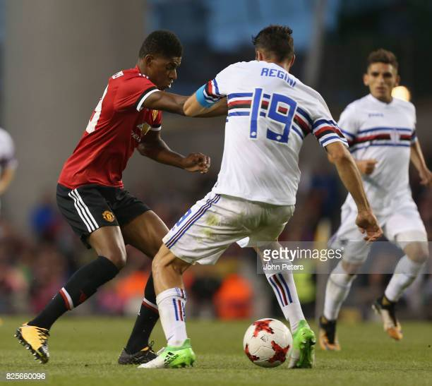 Marcus Rashford of Manchester United in action with Vasco Regini of Sampdoria during the International Champions Cup preseason friendly match between...