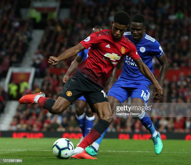 Marcus Rashford of Manchester United in action with Wes Morgan of Leicester City during the Premier League match between Manchester United and...