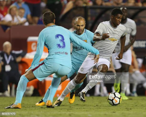 Marcus Rashford of Manchester United in action withAndres Inesta and Gerard Pique of Barcelona during the International Champions Cup 2017 preseason...
