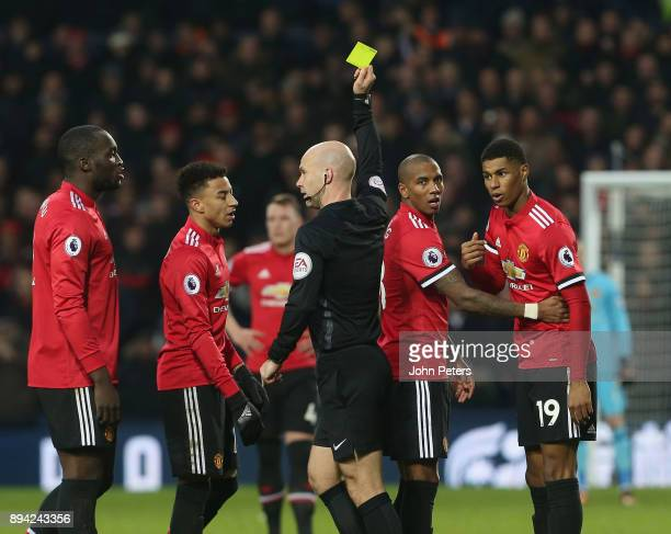 Marcus Rashford of Manchester United is booked by Referee Anthony Taylor during the Premier League match between West Bromwich Albion and Manchester...