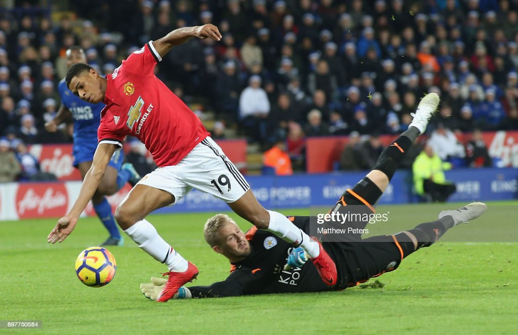 Marcus Rashford of Manchester United is brought down by Kasper Schmeichel of Leicester City but no penalty is given during the Premier League match between Leicester City and Manchester United at The King Power Stadium on December 23, 2017 in Leicester, England.