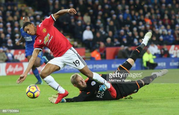 Marcus Rashford of Manchester United is brought down by Kasper Schmeichel of Leicester City but no penalty is given during the Premier League match...