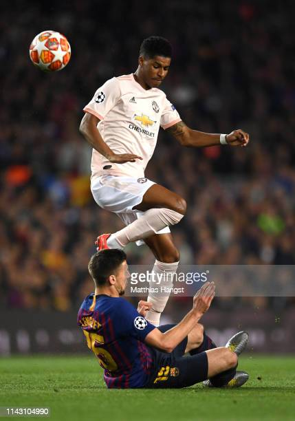 Marcus Rashford of Manchester United is challenged by Clement Lenglet of Barcelona during the UEFA Champions League Quarter Final second leg match...