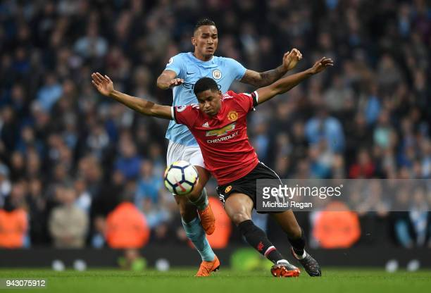 Marcus Rashford of Manchester United is challenged by Danilo of Manchester City during the Premier League match between Manchester City and...