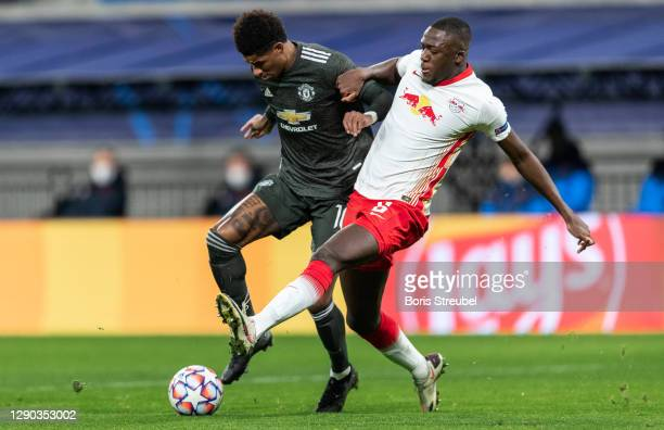 Marcus Rashford of Manchester United is challenged by Ibrahima Konate of RB Leipzig during the UEFA Champions League Group H stage match between RB...