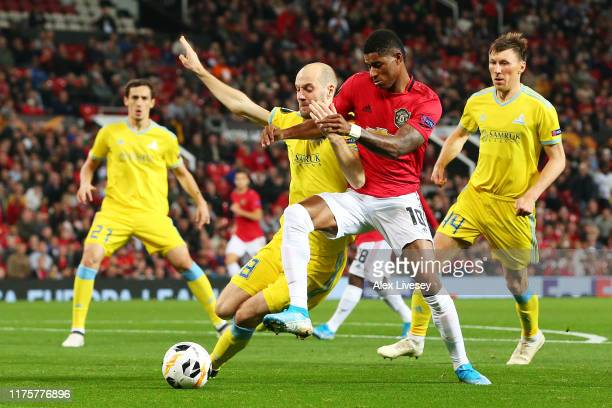 Marcus Rashford of Manchester United is challenged by Ivan Maevski of Asanta during the UEFA Europa League group L match between Manchester United...