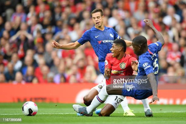 Marcus Rashford of Manchester United is challenged by Kurt Zouma of Chelsea which leads to a penalty for Manchester United during the Premier League...