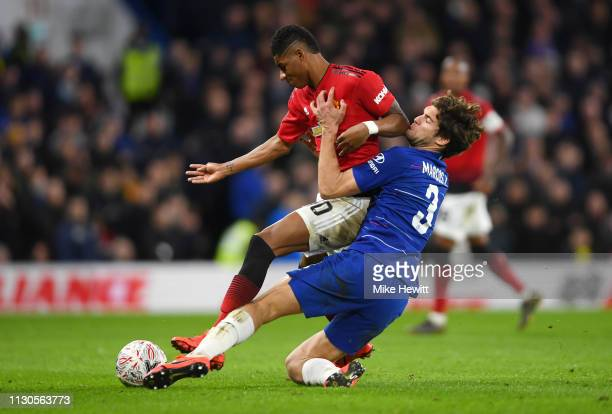 Marcus Rashford of Manchester United is challenged by Marcos Alonso of Chelsea during the FA Cup Fifth Round match between Chelsea and Manchester...