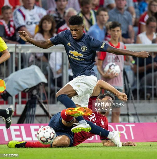 Marcus Rashford of Manchester United is challenged by Mats Hummels of FC Bayern Muenchen during the friendly match between Bayern Muenchen and...
