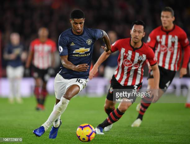 Marcus Rashford of Manchester United is challenged by Maya Yoshida of Southampton during the Premier League match between Southampton FC and...