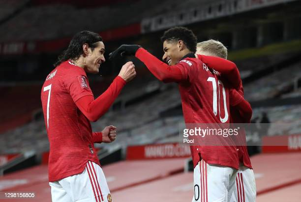 Marcus Rashford of Manchester United is congratulated by team mates Edinson Cavani and Donny Van De Beek after scoring their side's second goal...