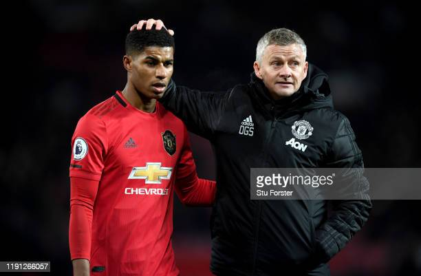 Marcus Rashford of Manchester United is consolled by Ole Gunnar Solskjaer Manager of Manchester United after the Premier League match between...