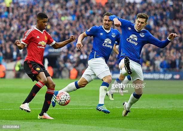Marcus Rashford of Manchester United is faced by John Stones and Phil Jagielka of Everton during The Emirates FA Cup semi final match between Everton...