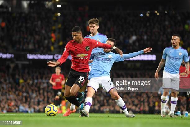 Marcus Rashford of Manchester United is fouled by Bernardo Silva of Manchester City resulting in a penalty during the Premier League match between...