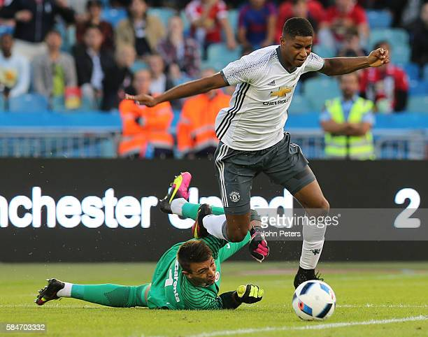 Marcus Rashford of Manchester United is fouled by Fernando Muslera of Galatasary to win a penalty during the preseason friendly match between...