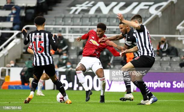 Marcus Rashford of Manchester United is fouled by Jamal Lewis of Newcastle United and a penalty is later awarded during the Premier League match...