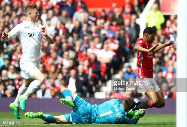 Marcus Rashford of Manchester United is fouled by Lukasz Fabianski of Swansea City and a penalty is awarded to Manchester United during the Premier...