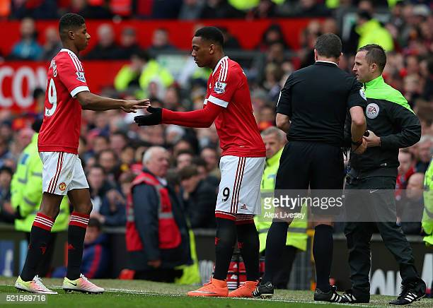 Marcus Rashford of Manchester United is replaced by Anthony Martial of Manchester United during the Barclays Premier League match between Manchester...