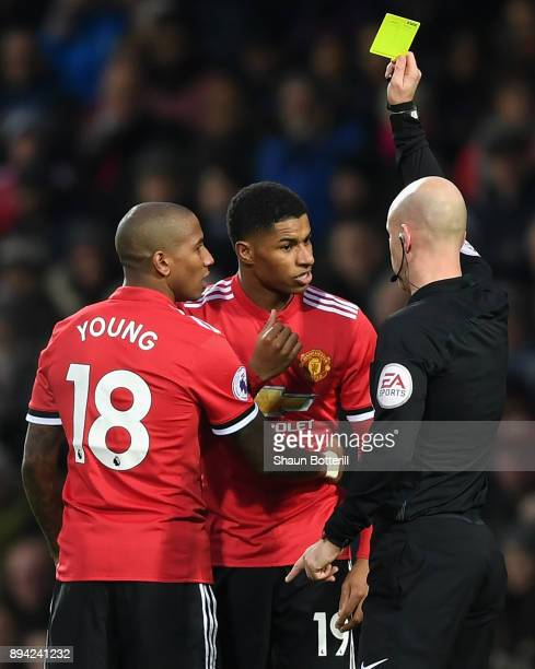 Marcus Rashford of Manchester United is shown a yellow card by referee Anthony Taylor during the Premier League match between West Bromwich Albion...