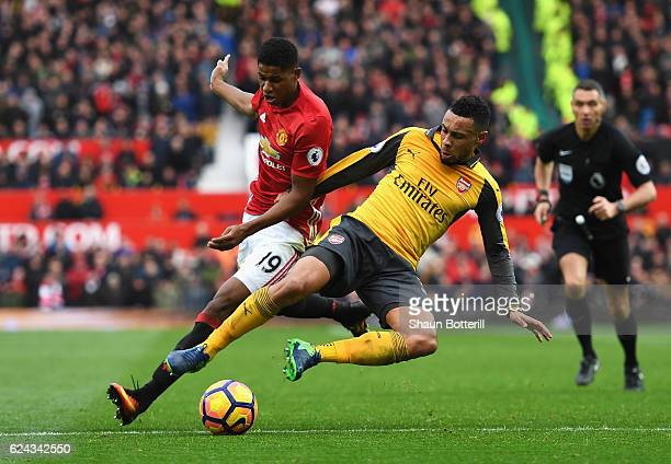Marcus Rashford of Manchester United is tackled by Francis Coquelin of Arsenal during the Premier League match between Manchester United and Arsenal...
