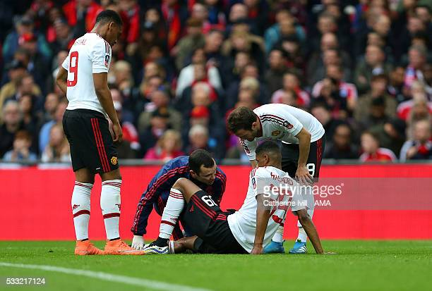 Marcus Rashford of Manchester United is treated for an injury during The Emirates FA Cup final match between Manchester United and Crystal Palace at...