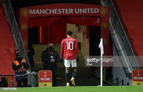 Marcus Rashford of Manchester United leaves the field after appearing to pick up an injury during The Emirates FA Cup Fourth Round match between...