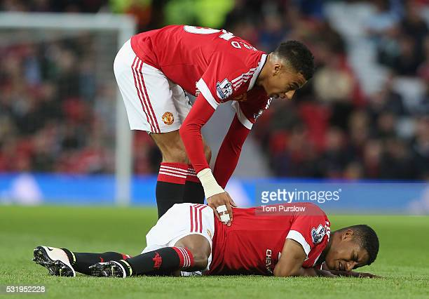 Marcus Rashford of Manchester United lies injured during the Barclays Premier League match between Manchester United and AFC Bournemouth at Old...