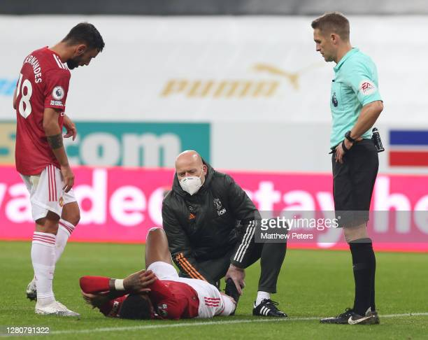 Marcus Rashford of Manchester United lies injured during the Premier League match between Newcastle United and Manchester United at St James Park on...